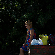 A local resident cools down at a shade of a tree, meters from the crash site of the Malaysia Airlines flight MH17 near Grabovo town in Donetsk, Eastern Ukraine. Malaysia Airlines flight was travelling from Amsterdam to Kuala Lumpur when it crashed killing all 298 on board including 80 children. The aircraft was allegedly shot down by a missile and investigations continue over the perpetrators of the attack.