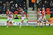 Ben Whiteman of Doncaster Rovers (8) scores a goal and celebrates to make the score 1-0 during the EFL Sky Bet League 1 match between Doncaster Rovers and Scunthorpe United at the Keepmoat Stadium, Doncaster, England on 15 December 2018.