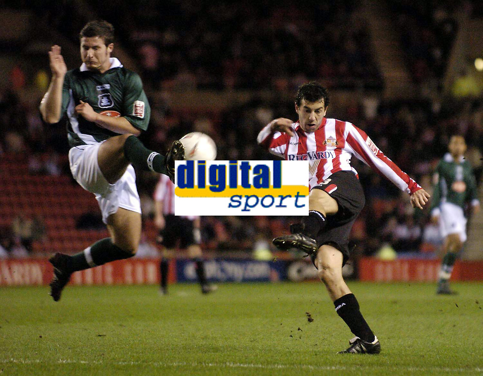Photo. Jed Wee.<br /> Sunderland v Plymouth Argyle, Coca Cola Championship, 15/03/2005.<br /> Sunderland's Julio Arca (R) has a shot charged down by Plymouth's David Norris.