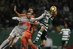 December 17, 2017 - Lisbon, Portugal - Sporting's forward Bas Dost (R) vies for the ball with Portimonense's goalkeeper Ricardo Ferreira (L)  during Primeira Liga 2017/18 match between Sporting CP vs Portimonense SC, in Lisbon, on December 17, 2017. (Credit Image: © Carlos Palma/NurPhoto via ZUMA Press)