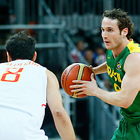 06 August 2012: Brazil Marcelinho Huertas looks to pass the ball during 88-82 Team Brazil victory over Team Spain, during the men's basketball preliminary, at the Basketball Arena, in London, Great Britain.
