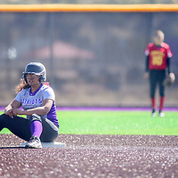 Miyamura Patriot Jazmine Arreguin (5) takes a seat at second base during a brief time out as the Patriots faced off with the Española Valley Sundevils at Miyamura High School in Gallup Thursday.