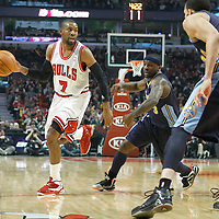 26 March 2012: Chicago Bulls point guard C.J. Watson (7) drives past Denver Nuggets point guard Ty Lawson (3) during the Denver Nuggets 108-91 victory over the Chicago Bulls at the United Center, Chicago, Illinois, USA. NOTE TO USER: User expressly acknowledges and agrees that, by downloading and or using this photograph, User is consenting to the terms and conditions of the Getty Images License Agreement. Mandatory Credit: 2012 NBAE (Photo by Chris Elise/NBAE via Getty Images)