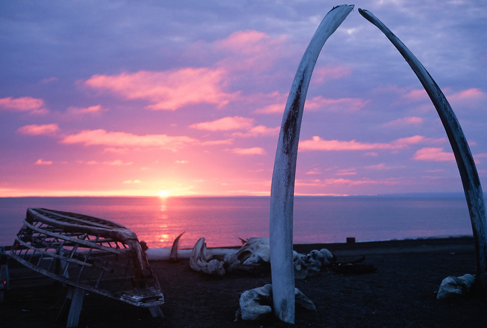 Barrow sunset by Bowhead whale jaw bones. Alaska.