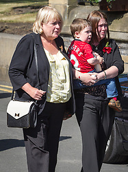 © Licensed to London News Pictures . 11/07/2013 . Bury , UK . L-R Susan (Rebecca's Mum), Rebecca Rigby holding Jack Rigby . Drummers from the 2nd Battalion Royal Regiment of Fusiliers ( 2RRF ) drum the funeral cortege of Fusilier Lee Rigby up Bolton Street and in to Bury Parish Church in Bury town centre today (Thursday 11th July 2013) , watched by 100s of people . Fusilier Rigby's coffin will remain in Bury Parish Church overnight , with an honour guard of soldiers from the Regiment . His funeral is tomorrow (12th July) . Rigby was brutally murdered in Woolwich , London on . Photo credit : Joel Goodman/LNP