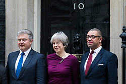 © Licensed to London News Pictures. 08/01/2018. London, UK. Prime Minister Theresa May (C), new Conservative Party Chairman Brandon Lewis (L) and new Deputy Conservative Party Chairman James Cleverly (R) outside 10 Downing Street, joined by colleagues from Conservative Party Headquarters. Photo credit: Rob Pinney/LNP