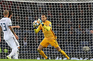 Guilherme Marinato of Russia (1) (Locomotiv Moscow) safely deals with the shot during the UEFA European 2020 Qualifier match between Scotland and Russia at Hampden Park, Glasgow, United Kingdom on 6 September 2019.
