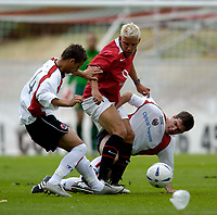 Fotball<br /> England 2005/2006<br /> Foto: SBI/Digitalsport<br /> NORWAY ONLY<br /> <br /> Clyde v Manchester United, Preseason Friendly. 16/07/2005.<br /> <br /> Manchester United's Alan Smith (C) is double-teamed by two Clyde defenders.