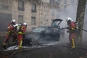 Mcc0086782 . Daily Telegraph<br /> <br /> DT News<br /> <br /> Pompiers extinguish fires from burnt out vehicles .<br /> <br /> Scenes on the on Ave de Freidland and Blvd Hausmann as protests turn violent in Paris for another weekend .<br /> <br /> Paris 8 December  2018