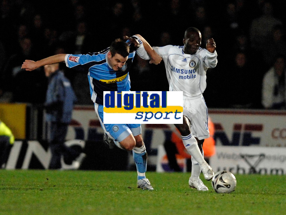 Photo: Richard Lane.<br />Wycombe Wanderers v Chelsea. Carling Cup, Semi Final 1st Leg. 10/01/2007. <br />Chelsea's Claude Makelele is challenged by Wycombe's Matt Bloomfield.