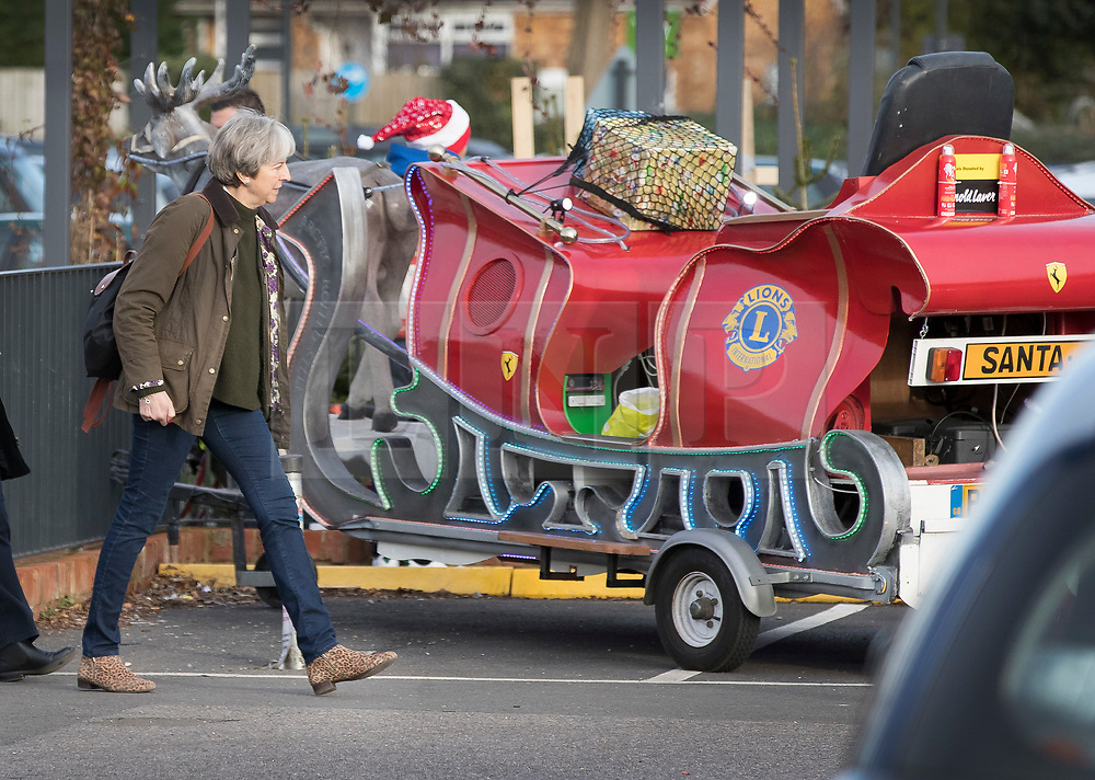 © Licensed to London News Pictures. 09/12/2017. Maidenhead, UK. Prime Minister Theresa May glances at a charity replica reindeer and sleigh as she visits a shop in her constituency. Photo credit: Peter Macdiarmid/LNP