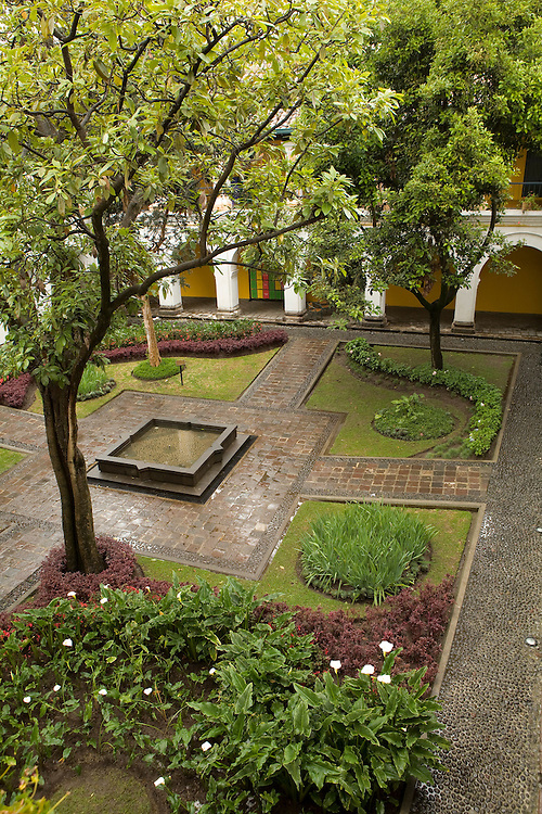 South America, Ecuador, Pichincha province, Quito. Courtyard with palm trees and garden in Museum of the City (Museo de la Ciudad) in old town colonial district.