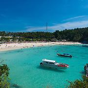 Tourists on the beach of Patok bay, Raya island, Thailand
