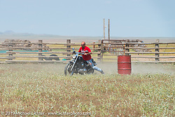 Mike Halachik barrel racing Hilary Goloda's Sportster at the Spur Creek Ranch north of Sturgis during a stop for food and cowboy games on the annual Michael Lichter - Sugar Bear Ride hosted by Jay Allen from the Easyriders Saloon during the Sturgis Black Hills Motorcycle Rally. SD, USA. Sunday, August 3, 2014. Photography ©2014 Michael Lichter.