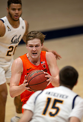 Feb 25, 2021; Berkeley, California, USA; Oregon State Beavers guard Zach Reichle (11) drives between California Golden Bears defenders Matt Bradley (20) and Grant Anticevich (15) during the first half of an NCAA college basketball game at Haas Pavilion. Mandatory Credit: D. Ross Cameron-USA TODAY Sports