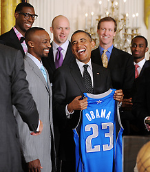 President Barack Obama holds a jersey as he poses at a ceremony with the NBA Champion Dallas Mavericks in the East room of the White House January 9, 2012 in Washington, DC, USA. Photo by Olivier Douliery/ABACAPRESS.COM  | 303722_002 Washington Etats-Unis United States