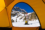 View from a yellow dome tent below Piute Pass in winter, Inyo National Forest, Sierra Nevada Mountains, California
