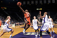 Oklahoma State guard Andrea Riley (10) dives between Kansas State defenders Danielle Zanotti (25), Shelee Lehning (5) and Shana Wheeler for the score, during second half action at Bramlage Coliseum in Manhattan, Kansas, February 28, 2007.  Oklahoma State beat K-State 64-55.
