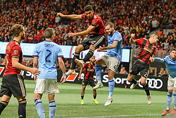 November 11, 2018 - Atlanta, GA, U.S. - ATLANTA, GA Ð NOVEMBER 11:  Atlanta's Miles Robinson (12) and NYCFC's Maxime Chanot (4) go high to get a corner kick during the MLS Eastern Conference semifinal match between Atlanta United and NYCFC on November 11th, 2018 at Mercedes-Benz Stadium in Atlanta, GA.  Atlanta United FC defeated New York City FC by a score of 3 to 1 to advance in the playoffs.  (Photo by Rich von Biberstein/Icon Sportswire) (Credit Image: © Rich Von Biberstein/Icon SMI via ZUMA Press)