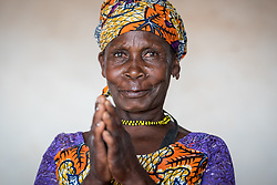 5 June 2019, Gado, Cameroon: Victorine Issowe is part of the host community in Gado, which has received more than 25,000 refugees from nearby Central African Republic. Today she is part of a group of 10 women, five from the host community and five refugees, who run a grain store for women. At a storage building in central Gado, they sell grains and flour, and rent out space for farmers who need space to store their own crops before consumption. The grain store has grown out of a livelihood-supporting activity of the Lutheran World Federation's World Service programme, and the women make sure to save 2,000 CAF per person every month, so they can also help other people in the community, particularly people with special needs.  Supported by the Lutheran World Federation, the Gado refugee camp in he East region of Cameroon hosts more than 25,000 refugees from neighbouring Central African Republic.