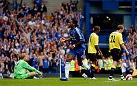 Photo: Daniel Hambury.<br />Chelsea v Manchester City. The Barclays Premiership. 20/08/2006.<br />Chelsea's Didier Drogba (centre) celebrates his goal as Manchester City's players show dejection.