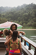 Paraty, Brazil - March 17, 2019: Brazilians enjoy a popular boat day trip to several beaches and swimming areas in Paraty, Rio de Janeiro State, Brazil.