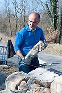 Stonemason Mitja Kobal, building a dry stone wall in the village of Kosovelje, Kras (Karst) region, Slovenia © Rudolf Abraham