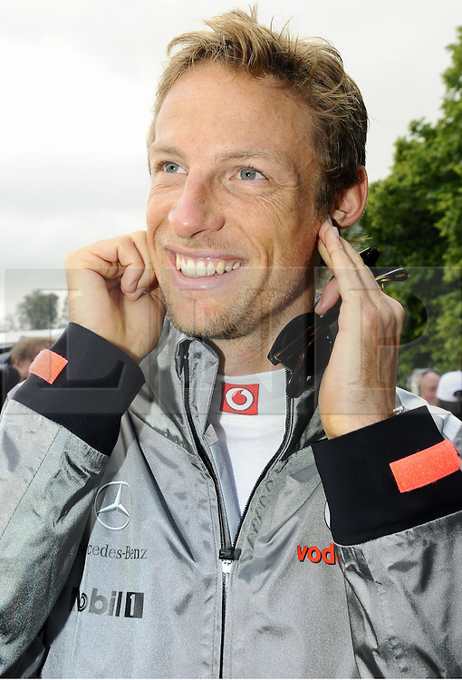 © Licensed to London News Pictures. 30/06/2012 .Jenson Button at Goodwood Festival of Speed.The Goodwood Festival of Speed is the largest motoring garden party in the world - a unique summer weekend, The largest car culture event in the world. Held in the grounds of Goodwood House, Chichester..Photo credit : Grant Falvey/LNP