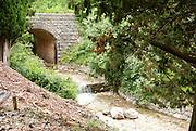 small stream flows under a stone bridge, near Becici, Budva Riviera, Montenegro