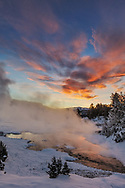Brilliant sunrise clouds over Grassy Spring at Mammoth Hot Springs in Yellowstone National Park, Wyoming, USA