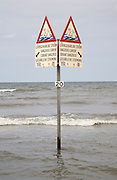 Sign warning of dangerous currents in four languages, Holland