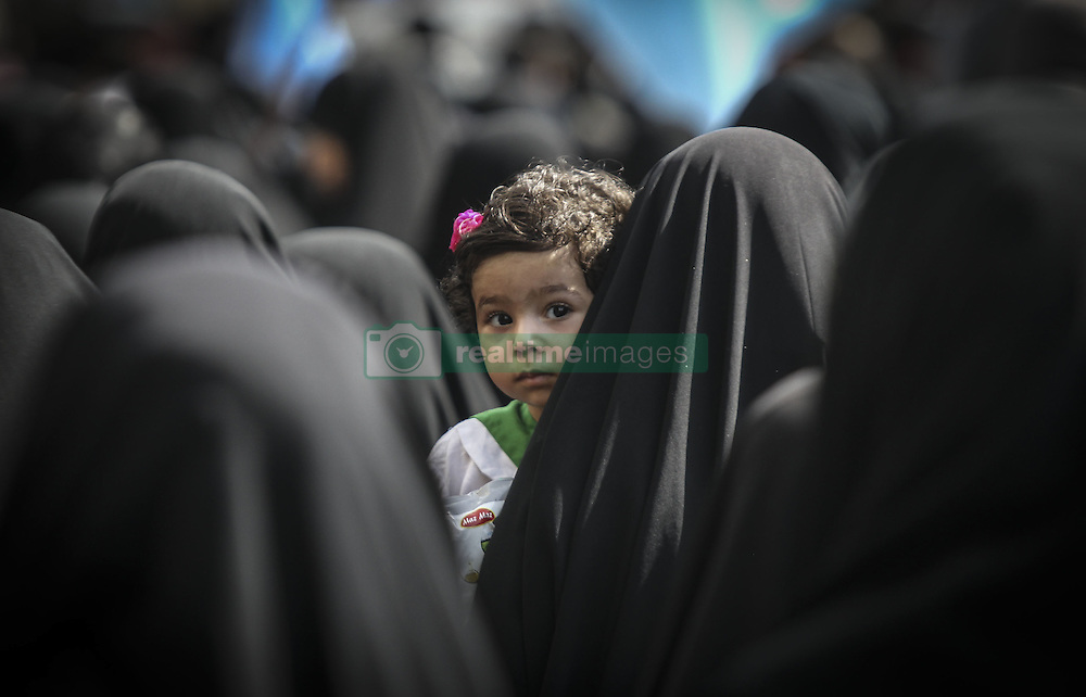 Oct. 4, 2015 Tehran, Iran - An Iranian girl attends a funeral ceremony in downtown Tehran, Iran. Thousands of Iranians held ceremonies on Sunday to mourn their pilgrims who died in the latest Hajj stampede in Saudi Arabia on Sept. 24. The ceremonies were held in the capital, Tehran, and Iran's other cities to see off the dead bodies of 104 Iranian pilgrims that were transferred to Tehran on Saturday.  (Credit Image: © Ahmad Halabisaz/Xinhua via ZUMA Wire)