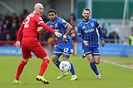 Sean Clohessy defender for Leyton Orient (2), Andy Barcham midfielder for AFC Wimbledon (17) and Callum Kennedy defender for AFC Wimbledon (3) during the Sky Bet League 2 match between AFC Wimbledon and Leyton Orient at the Cherry Red Records Stadium, Kingston, England on 23 April 2016. Photo by Stuart Butcher.