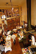 A variety of entrees are cooked in a brick oven in the middle of the dining room at Zuni Cafe on Market Street in San Francisco, CA., on Tuesday, Oct. 23, 2007. ..PHOTOGRAPHER: Erin Lubin/Bloomberg News.