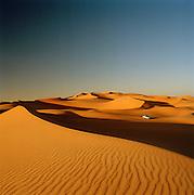 4x4 driving in the Sahara Desert at sunset, Libya