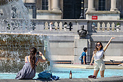 People are seen dipping their feet in Trafalgar Square fountains in London on Wednesday, June 24, 2020, as the UK officially recorded its warmest day of the year so far when the temperature reached 32.6C (90.7F) at London's Heathrow Airport at 2.46pm. (Photo/ Vudi Xhymshiti)
