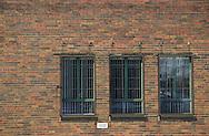 Three windows on a brick building.