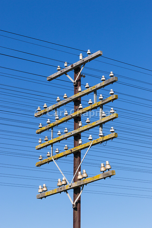 railway power and communications signalling cables on pole at Illabo, New South Wales, Australia <br /> <br /> Editions:- Open Edition Print / Stock Image