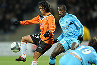FOOTBALL - FRENCH CHAMPIONSHIP 2009/2010  - L1 - FC LORIENT v OLYMPIQUE MARSEILLE - 16/12/2009 - PHOTO PASCAL ALLEE / DPPI - MARAMA VAHIRUA (LOR) / SOULEYMANE DIAWARA (OM)