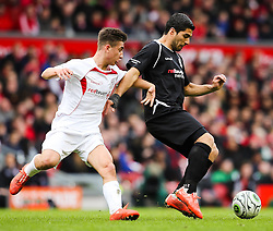 Luis Suarez of the Gerrard XI attacks - Photo mandatory by-line: Matt McNulty/JMP - Mobile: 07966 386802 - 29/03/2015 - SPORT - Football - Liverpool - Anfield Stadium - Gerrard's Squad v Carragher's Squad - Liverpool FC All stars Game