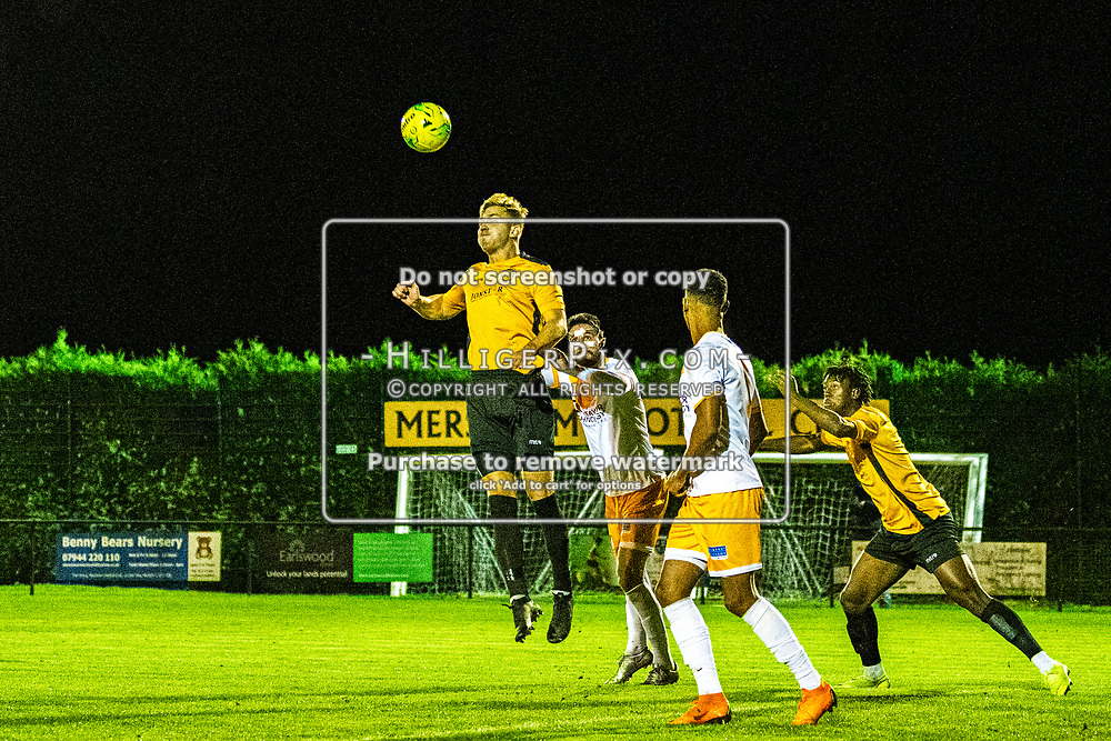 MERSTHAM, UK - OCTOBER 15: The defender raises highest to head the ball clear during the BetVictor Isthmian Premier League match between Merstham and Cray Wanderers at The Whisky Bible Stadium on October 15, 2019 in Merstham, UK. <br /> (Photo: Jon Hilliger)