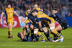 Jordan Crane (capt) of Bristol Rugby is tackled by Michael van Vuuren of Bath Rugby as Jon Fisher of Bristol Rugby clears out Charlie Ewels of Bath Rugby - Rogan Thomson/JMP - 20/10/2016 - RUGBY UNION - The Recreation Ground - Bath, England - Bath Rugby v Bristol Rugby - EPCR Challenge Cup.