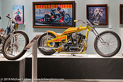 "Dan Rognsvoogs Harley-Davidson Sportster digger in the ""Built for Speed"" exhibition curated by Michael Lichter and Paul D'Orleans in the Russ Brown Events Center as part of the annual ""Motorcycles as Art"" series at the Sturgis Buffalo Chip during the Black Hills Motorcycle Rally. SD, USA. August 7, 2014.  Photography ©2014 Michael Lichter."