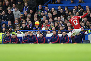 Chris Smalling of Manchester United in action while Louis van Gaal, the Manchester United Manager and Ryan Giggs, the Manchester United Coach  and the staff look on from the bench. Barclays Premier league match, Chelsea v Manchester Utd at Stamford Bridge in London on Sunday 7th February 2016.<br /> pic by John Patrick Fletcher, Andrew Orchard sports photography.