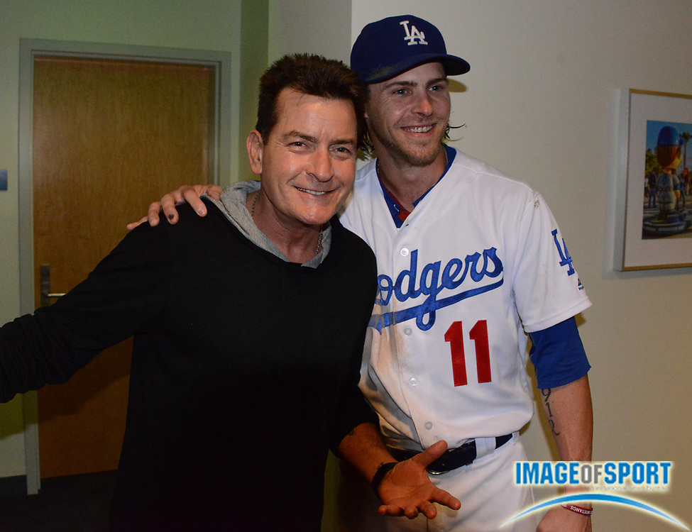 Sep 6, 2016; Los Angeles, CA, USA; Film actor Charlie Sheen (left) poses with Los Angeles Dodgers right fielder Josh Reddick (11) during a MLB game against the Arizona Diamondbacks at Dodger Stadium.