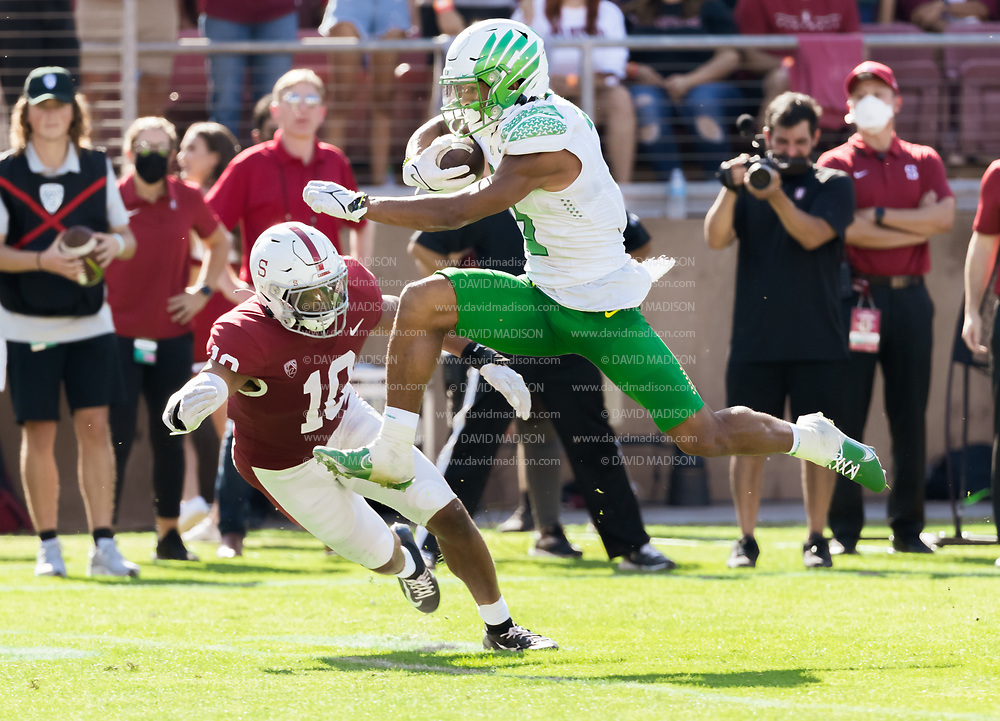 PALO ALTO, CA - OCTOBER 2:  Johnny Johnson III #3 of the  Oregon Ducks attempts to avoid a tackle by Jordan Fox #10 of the Stanford Cardinal during an NCAA Pac-12 college football game on October 2, 2021 at Stanford Stadium in Palo Alto, California.  (Photo by David Madison/Getty Images)