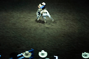 Mid Western rodeo with a cowboy on a horse in the arena