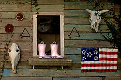 03 Jan 2006. New Orleans, Louisiana.<br /> Pink Boots. Items taken by a child during the mass evacuation of the city for hurricane Katrina return home.<br /> Photo©; Charlie Varley/varleypix.com