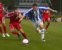 Photo: Matt Bright/Sportsbeat Images.<br /> Brighton & Hove Albion v Carlisle United. Coca Cola League  1. 24/11/2007.<br /> Nicky Forster of Brighto escapes the clutches of  David Raven of Carlisle