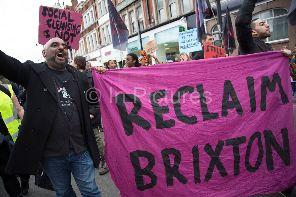"""London, UK. Saturday 25th April 2015. With gentrification devastating Brixton's famouscharacter and community, local activists, residents and campaigners gathered for a 'Reclaim Brixton' protest. Organised to celebrate Brixton's """"community, its diversity, culture, life and resistance"""". Social diversity is being driven out by lack of truly affordable housing. Local businesses by increasing rents and redevelopment schemes that benefit national & multinational rather than local businesses. Local spaces for people to meet, get support or education are being decimated as community groups, long-standing pubs, music venues, libraries & colleges are being relocated, repurposed, disappeared. Brixton's vibrancy now has a question mark on it."""